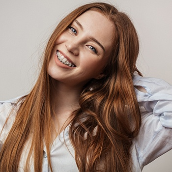 Young woman with ceramic braces