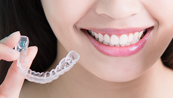 Closeup of smile and clear aligner