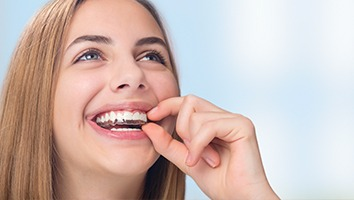 Woman placin clear aligner