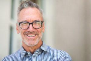 Middle-aged man smiling after using Acceledent